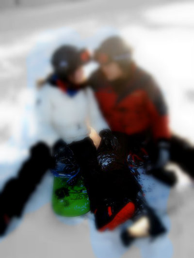 Couple Snowboarding
